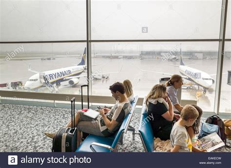 Passengers waiting to board Ryanair plane at Stansted